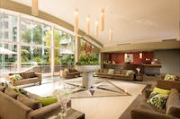 Relax in this stylish hotel lobby overlooking beautifully landscaped tropical gardens