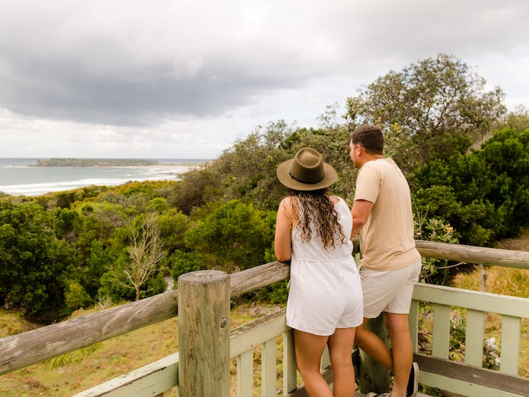 A lady and a man enjoying views at a lookout