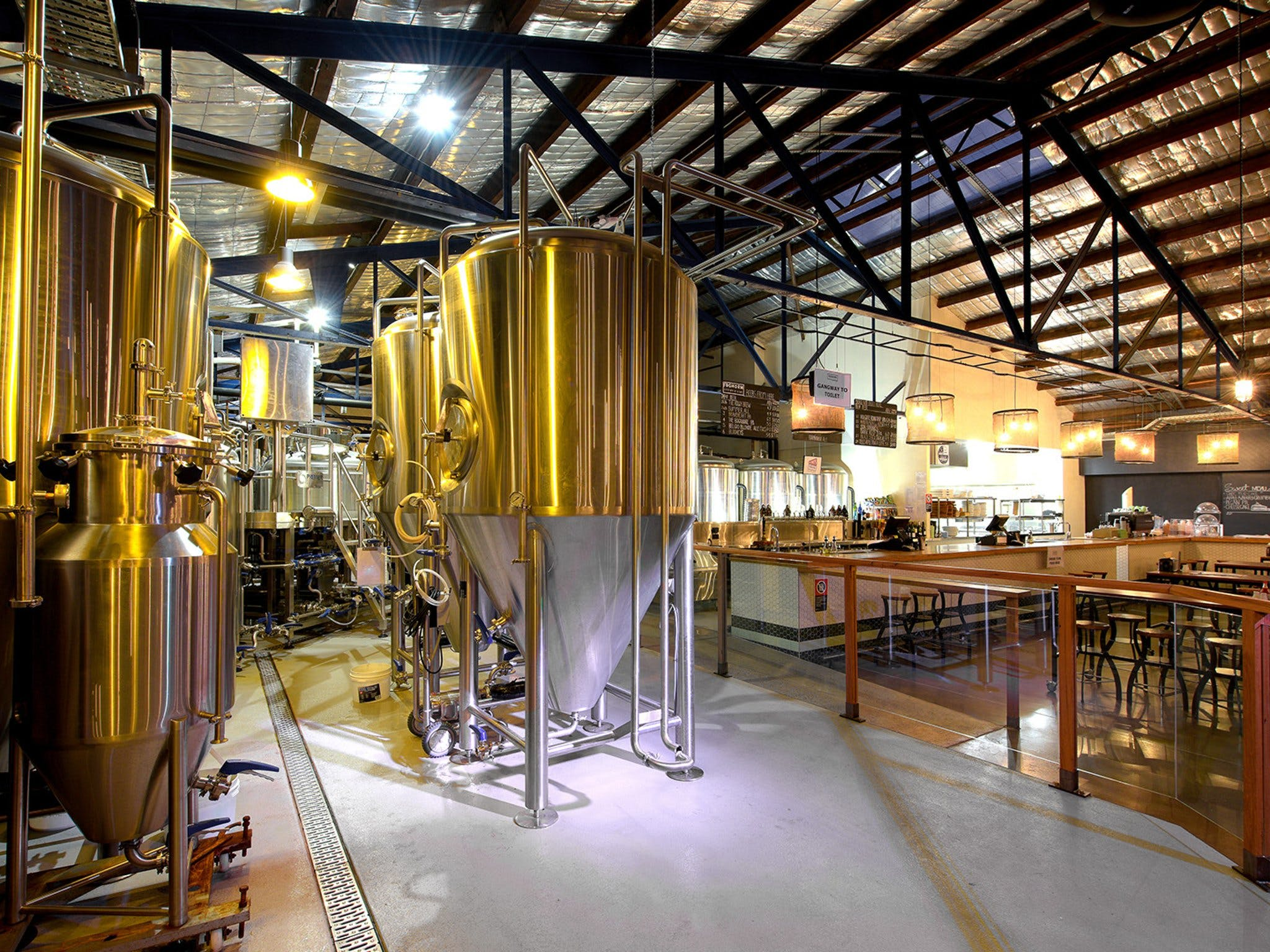 Interior of FogHorn Brewhouse with fermentation tanks in brewery area