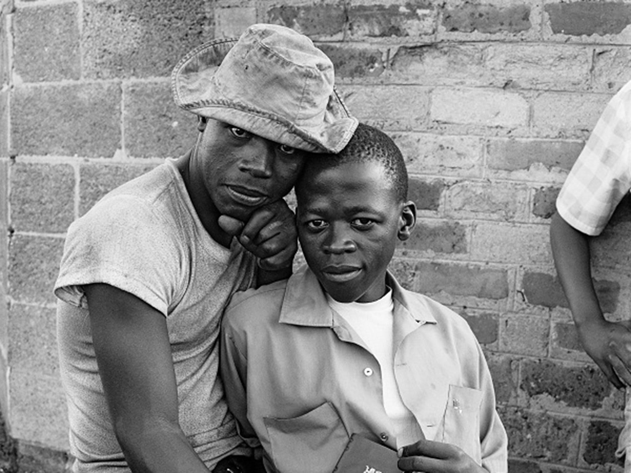 Young men with dompas (an identity document that every African had to carry), White City, Soweto