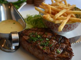 Delicious steak, chips and sauce