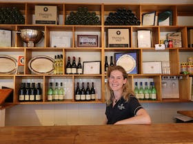 Photo of Connie, the host of Tranquil Vale vineyard at the Cella Door.