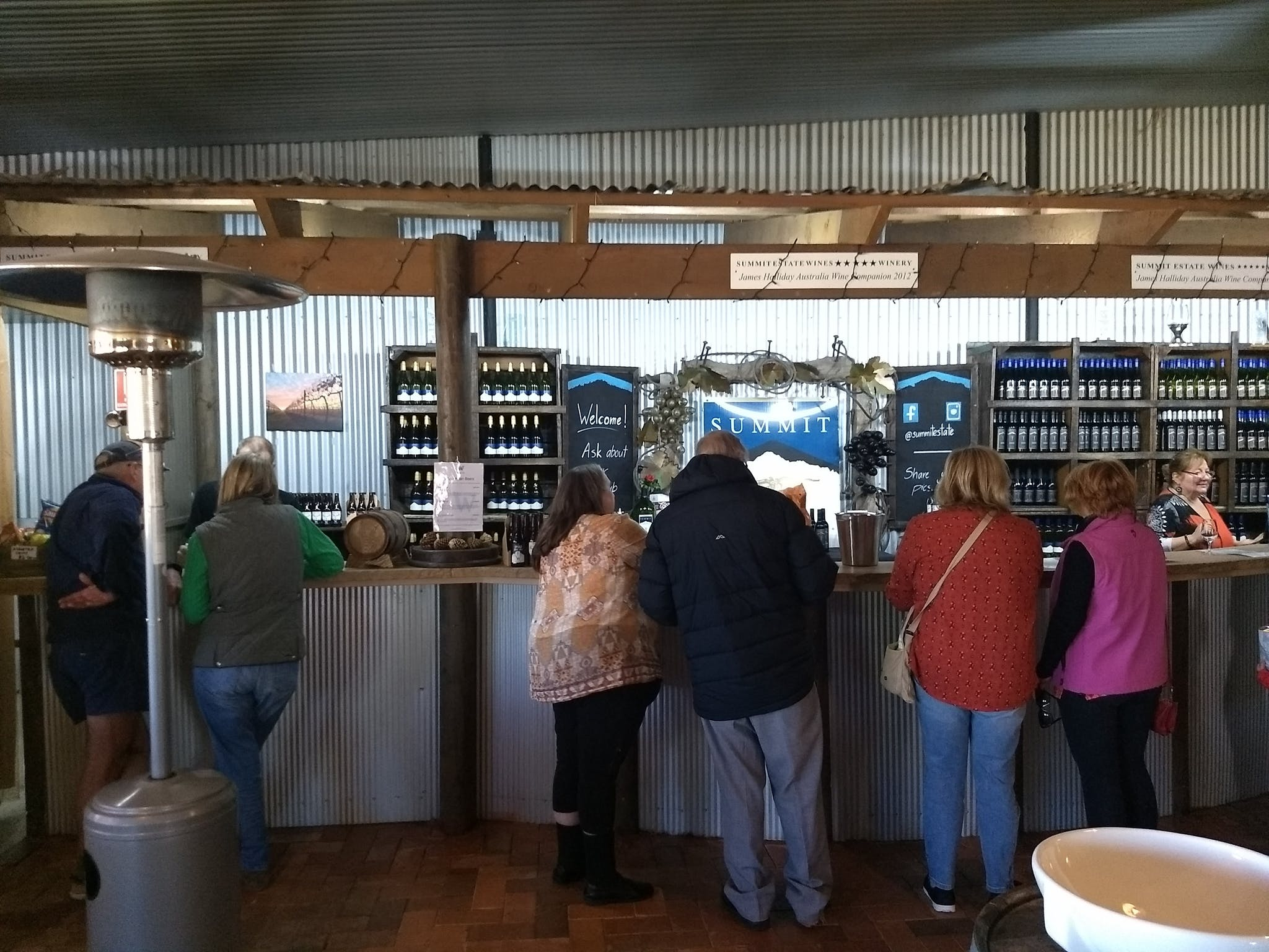 People standing wine tasting