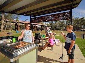 Family enjoying a BBQ at Moama Beach