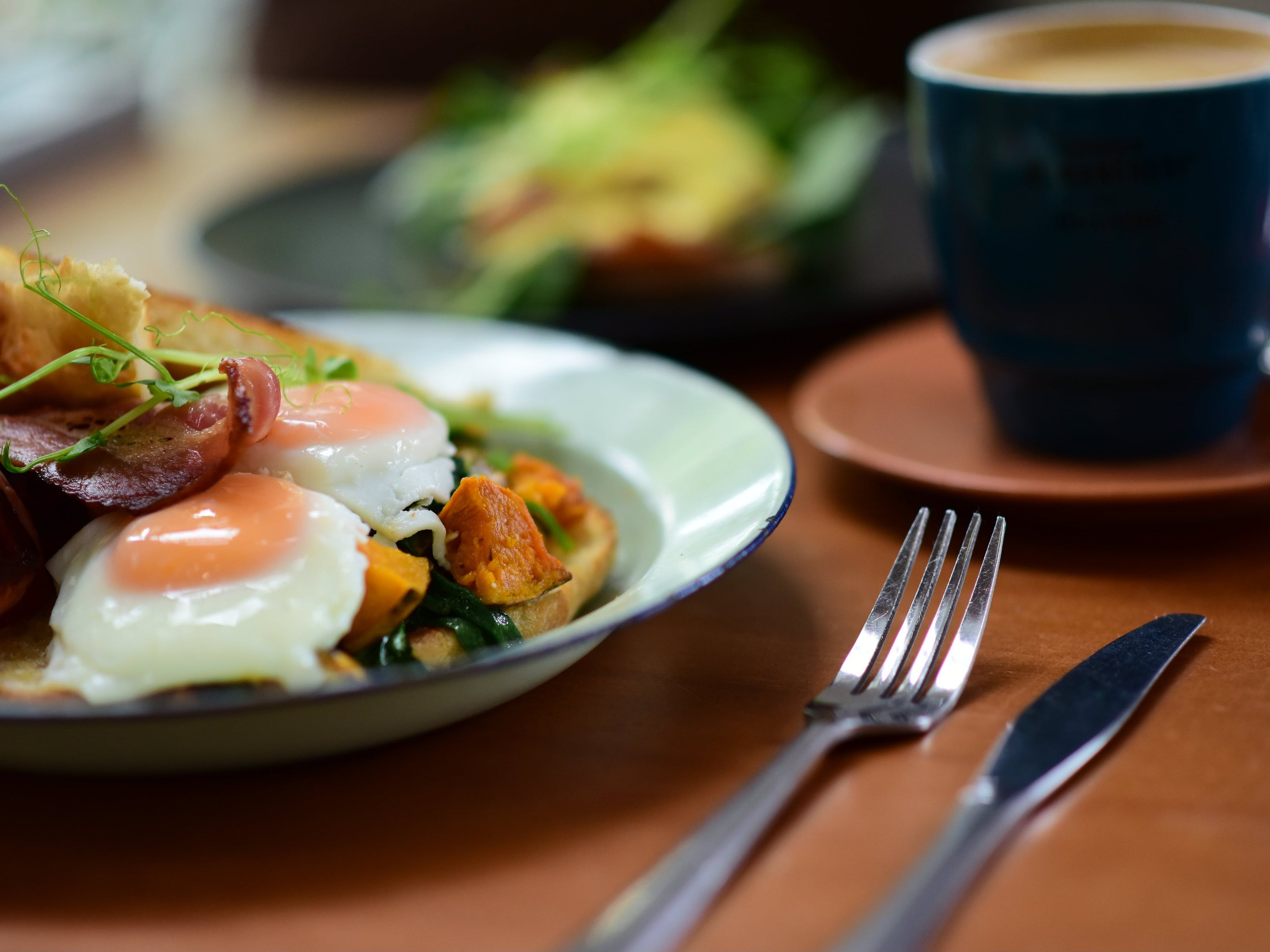 Bacon, eggs and bubble and squeak with a mug of coffee