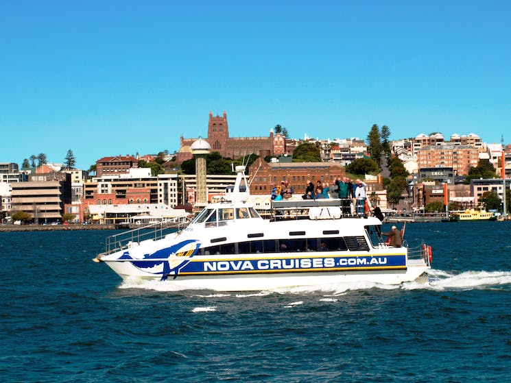 Side shot of vessel 'Bay Connections' cruising with Newcastle in background