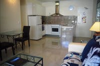 One Bedroom Deluxe Kitchen and Living Space Palm Cove Tropic