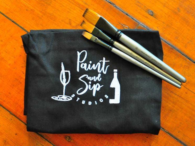 Apron with paint brushes ready to paint