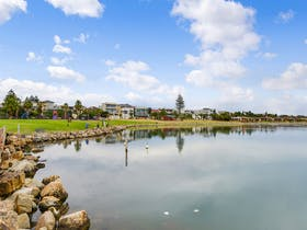 The lake is often used for rowing championships.  Playground closeby and easy walk to the beach.