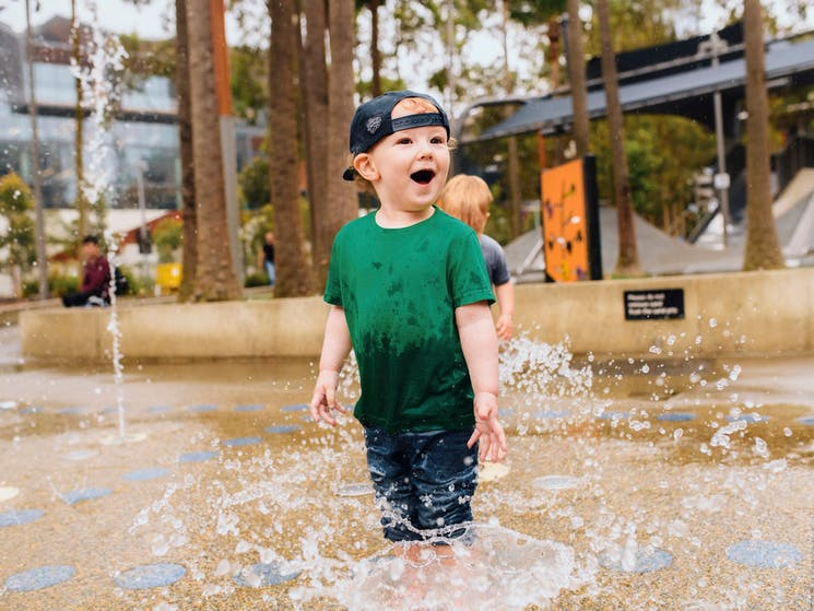 Young boy having a fun day out at The Playground, Darling Quarter