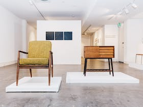 gallery with chair and cabinet