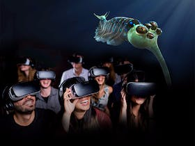 Visitors having one of David Attenborough's Virtual Reality Experiences