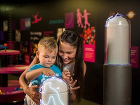 Mother and child playing in Energy for Life Discovery Centre