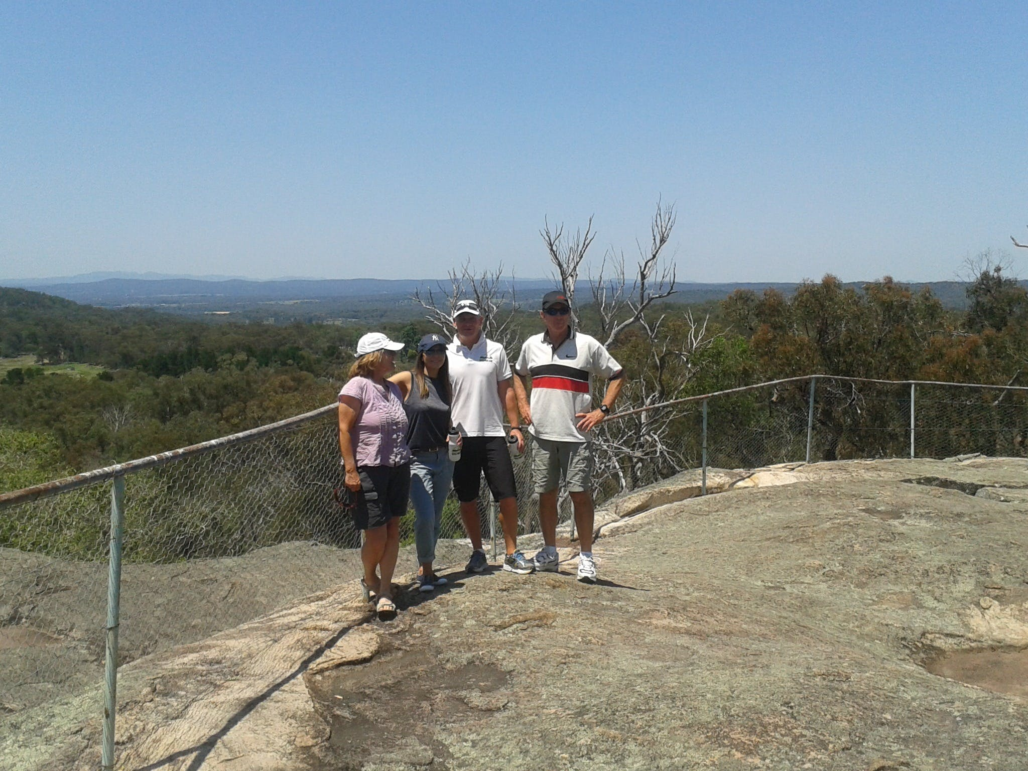 people on top of a rock lookout