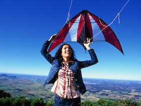 Woman with kite at Cambewarra Lookout