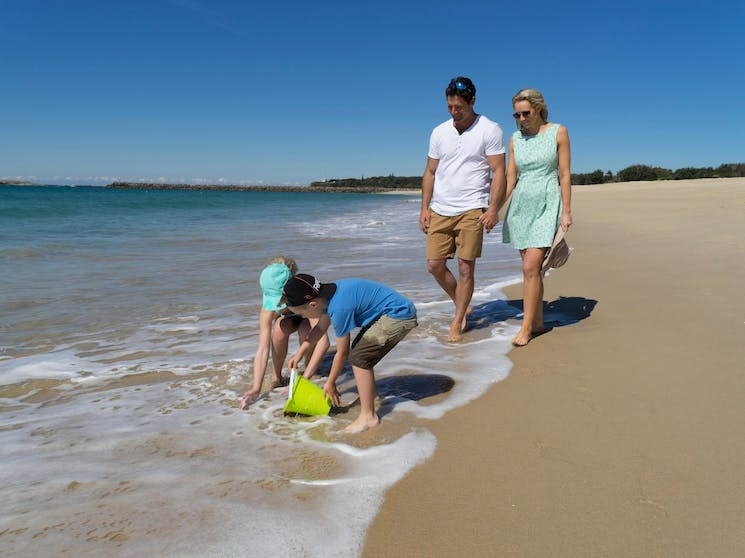 Family walking on Blacksmiths Beach