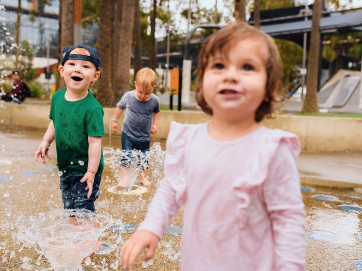 Children having a fun day out at The Playground, Darling Quarter
