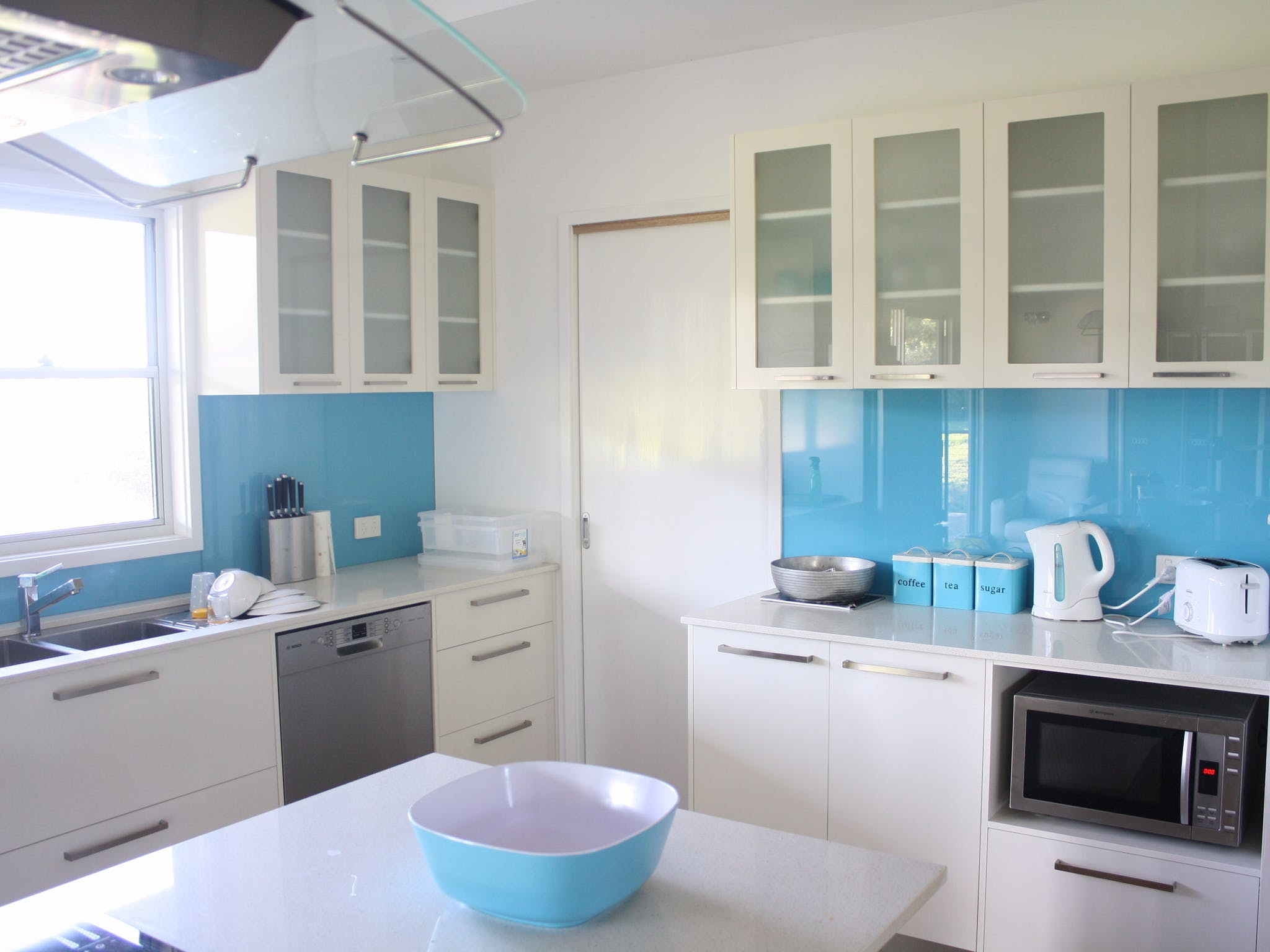 The large kitchen features induction stove with oven, large pantry and everything you need to feast