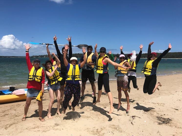 Kayak tour group on the sandspit in Bundeena