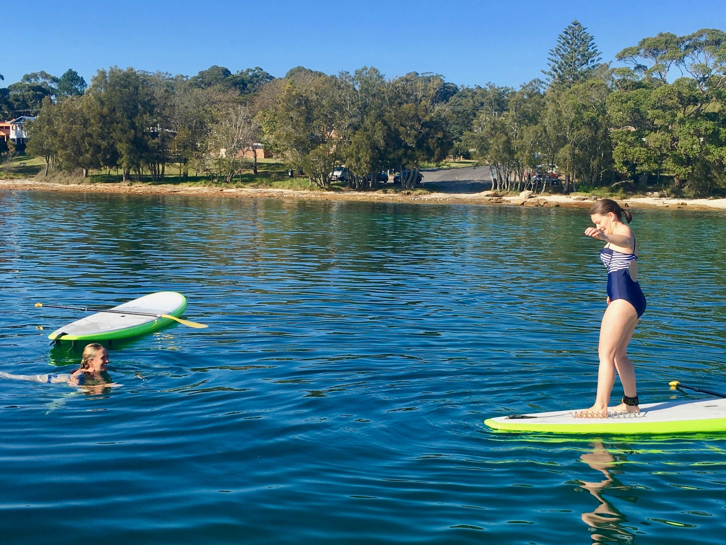 A reverse surf stance before the big splash, great paddle girls you deserve a dip to cool down.