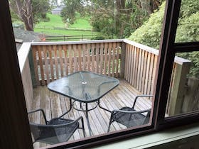 Seating space on deck overlooking gardens
