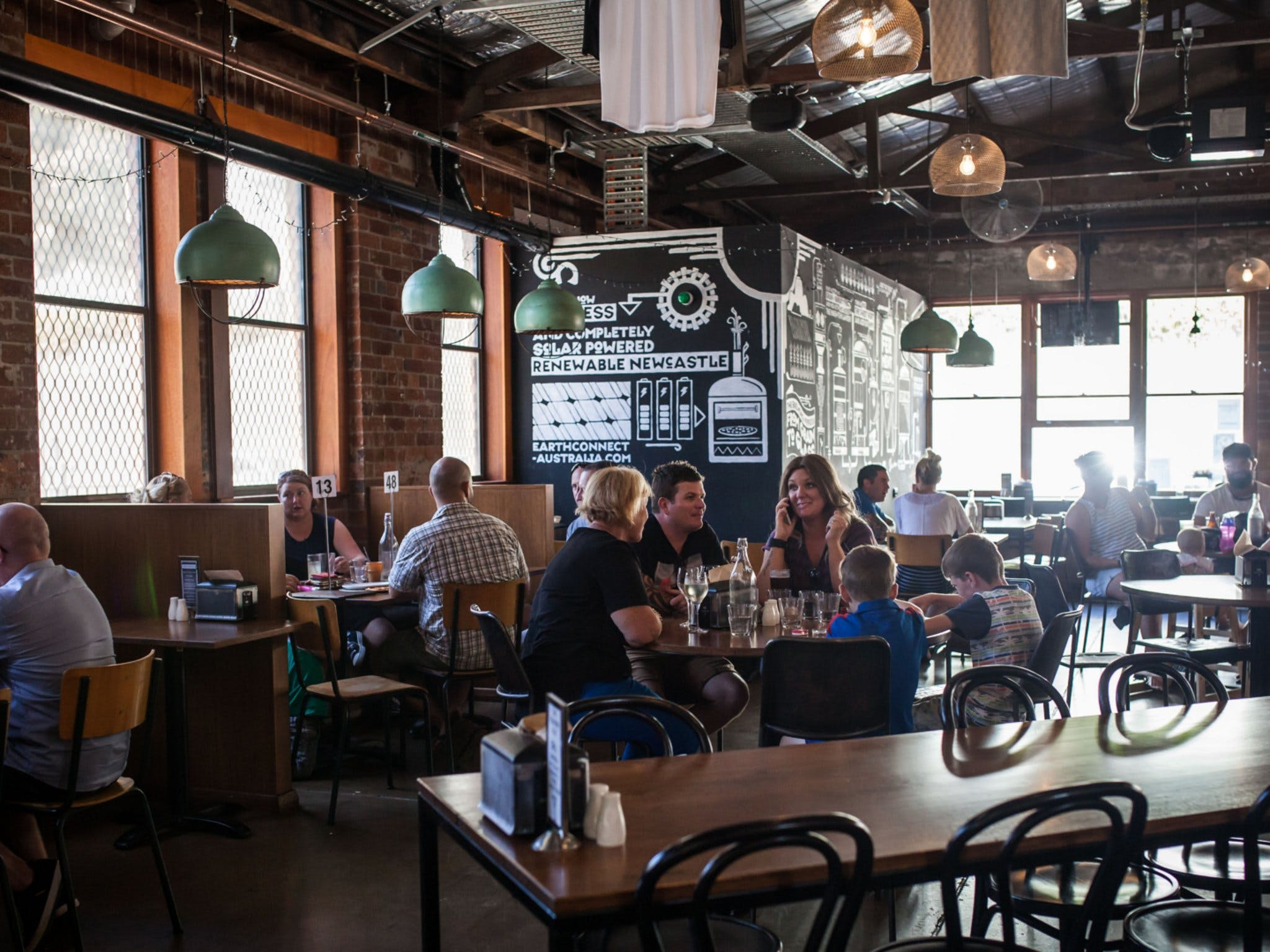 Many customers and young families dining inside FogHorn Brewhouse
