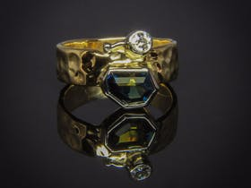 Handmade hammered band ring, with uneven sided custom cut Queensland blue, green and yellow Sapphire