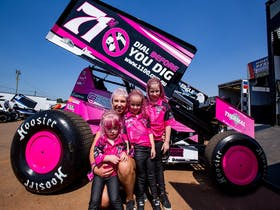 Lady Sprintcar driver with children