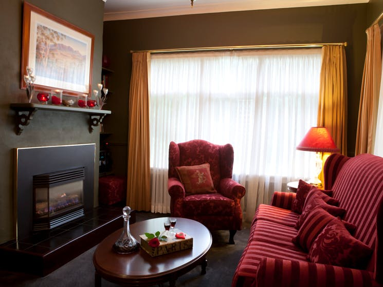 Plush lounge room complete with gas-log fireplace and complimentary port