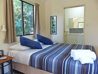 Interior image of queen bed and ensuite