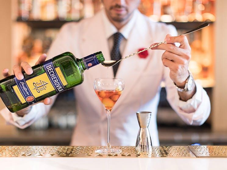 Bartender making cocktail at Maybe Sammy bar in The Rocks Sydney