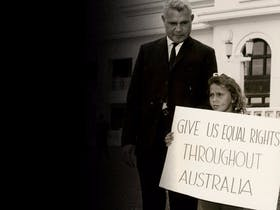 Former boxer Jack Hassen and his daughter demonstrating outside Parliament House, Canberra, in the l