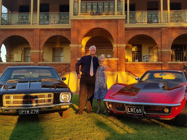 Vintage cars on lawn at museum