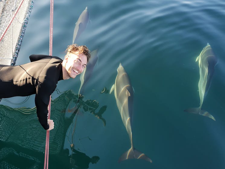 Manager Matt MacCabe getting up close & personal with the dolphins.
