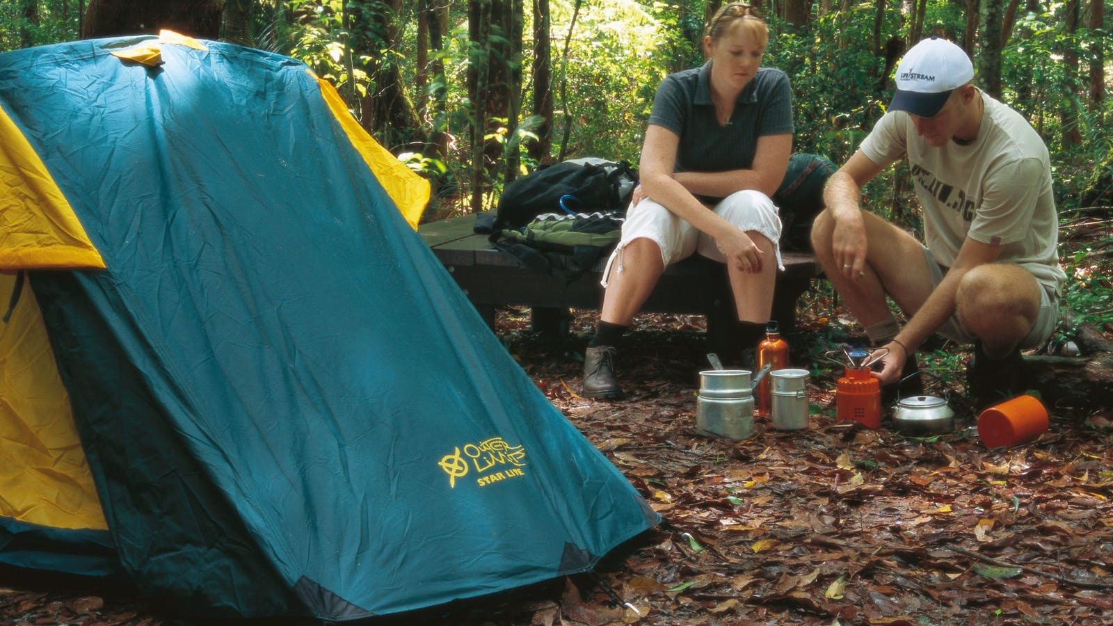 Tent and campers in forest, Fraser Island