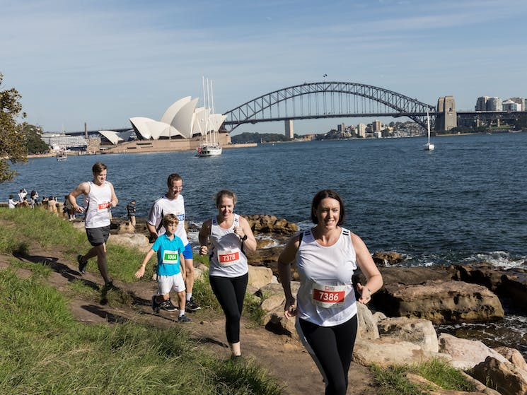 Runners along the harbour