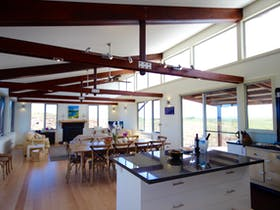Open plan living, dining, kitchen at Turnstone Beach House