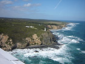 Flying past Cape Otway lighthouse with 12 Apostles Flight Adventures departing Torquay Airport