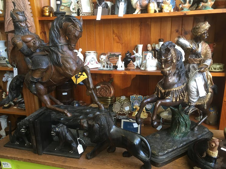 Brass and Bronze statues and shelves of timber and china ornaments