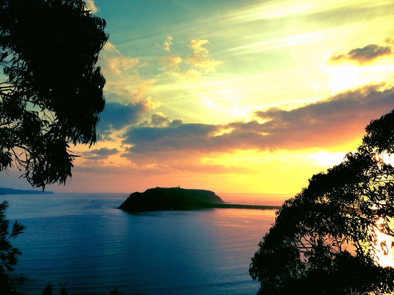 Barrenjoey headland and Pittwater at sunrise after a kayak and bushwalk,