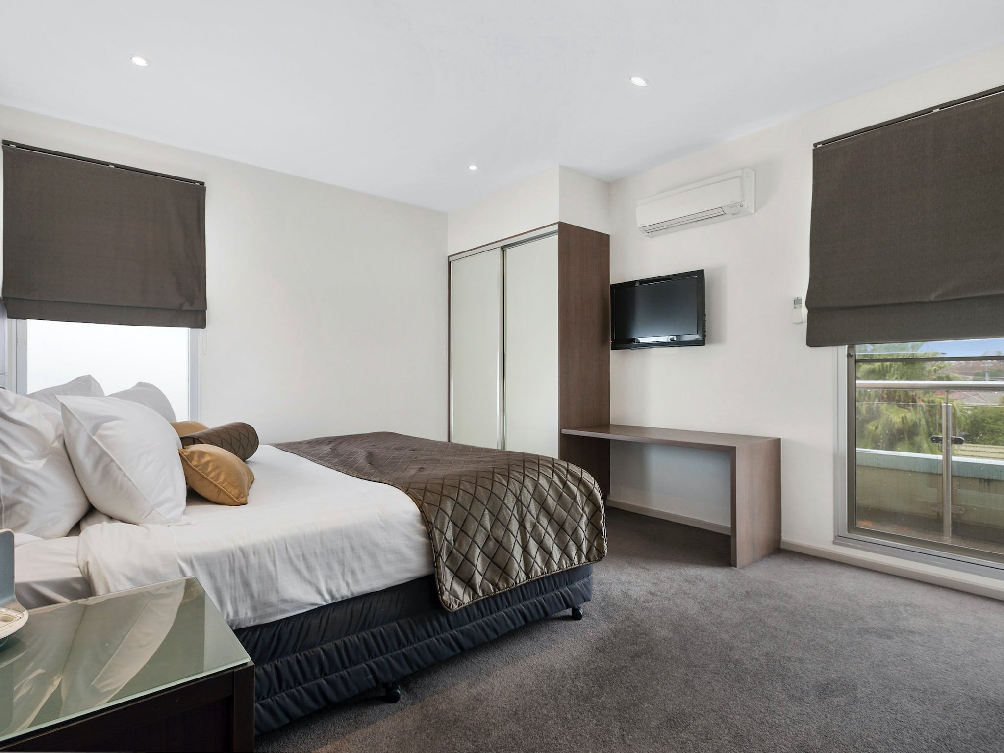 Master bedroom with wardrobe, flat screen television and window