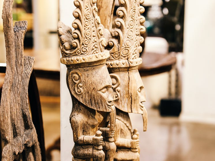 Intricately hand carved house posts from East Timor