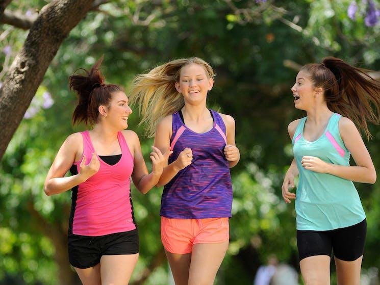 Three young women on walking path