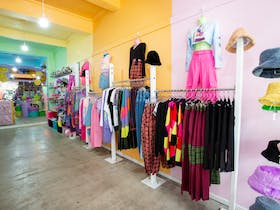The racks of fun clothing in store.