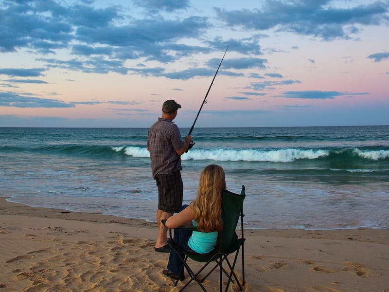 A couple fishing at the shore