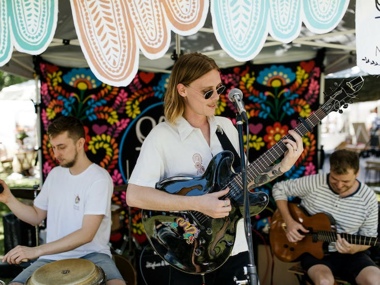 Relax to live music all day at The Olive Tree Market