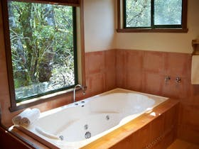 Cradle Mountain view spa cottage, rectangular spa bath, very romantic and comfortable spa cottage