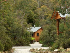Open plan studio cabins offer cosy and warm cabin accommodation at Cradle Mountain