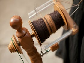 Spinning brown wool at the Old Bus Depot Markets for A Celebration of Wool