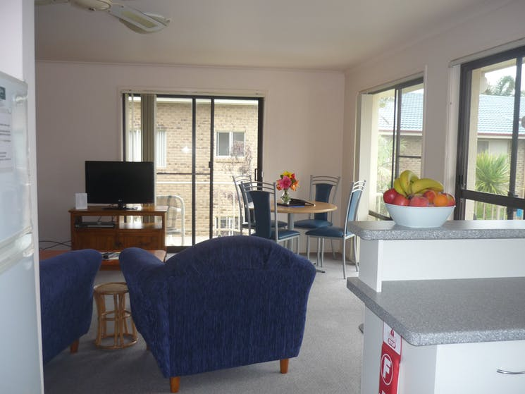 Living area showing dining table and chairs